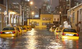 Yellow cabs line a flood street in Queens, New York in hurricane Sandy's wake